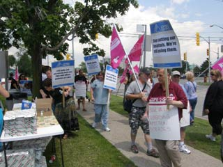 OPSEU members holding signs