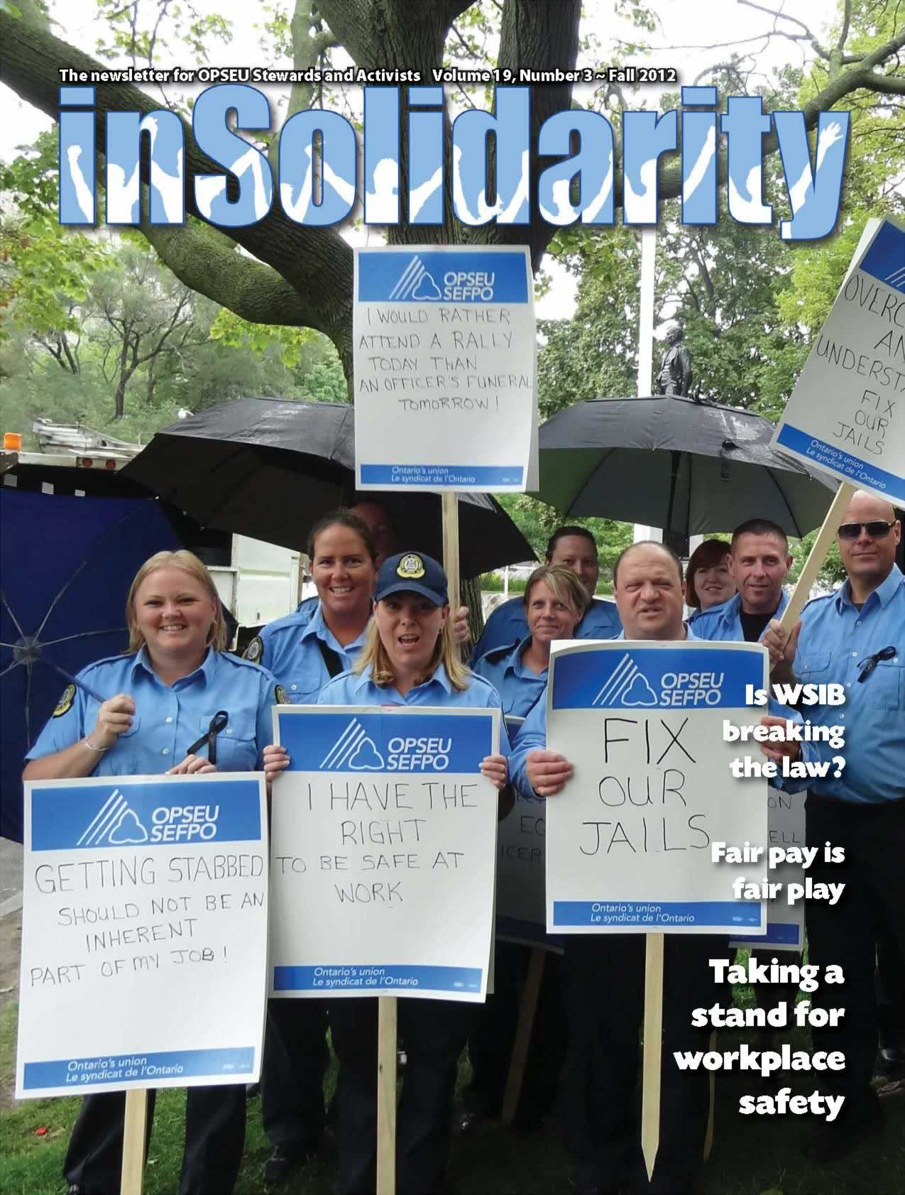 In Solidarity, Fall 2012 cover. Correctional officers holding up signs that say: Fix our jails