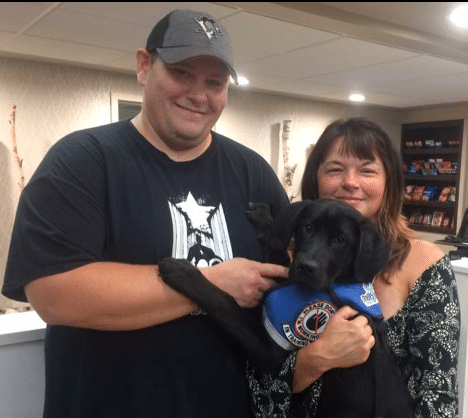 chair_mike_lundy_with_united_by_trauma_founder_nicole_taylor_and_a_new_addition_to_the_service_dog_family.png