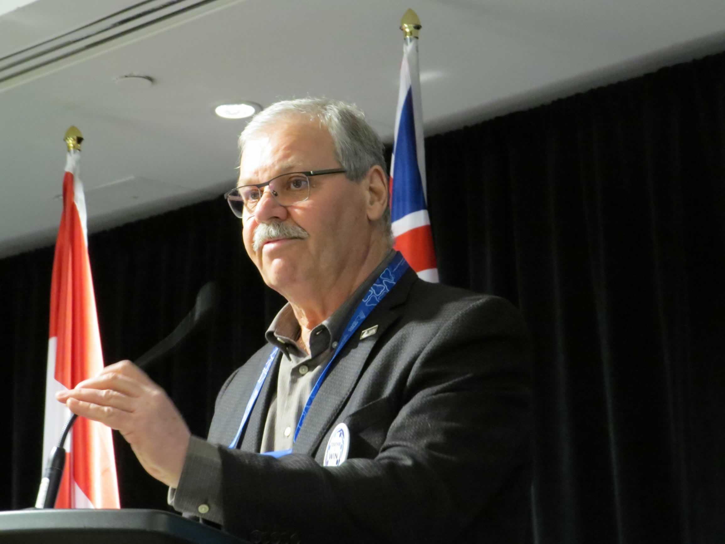 OPSEU President Warren (Smokey) Thomas speaks at a podium.