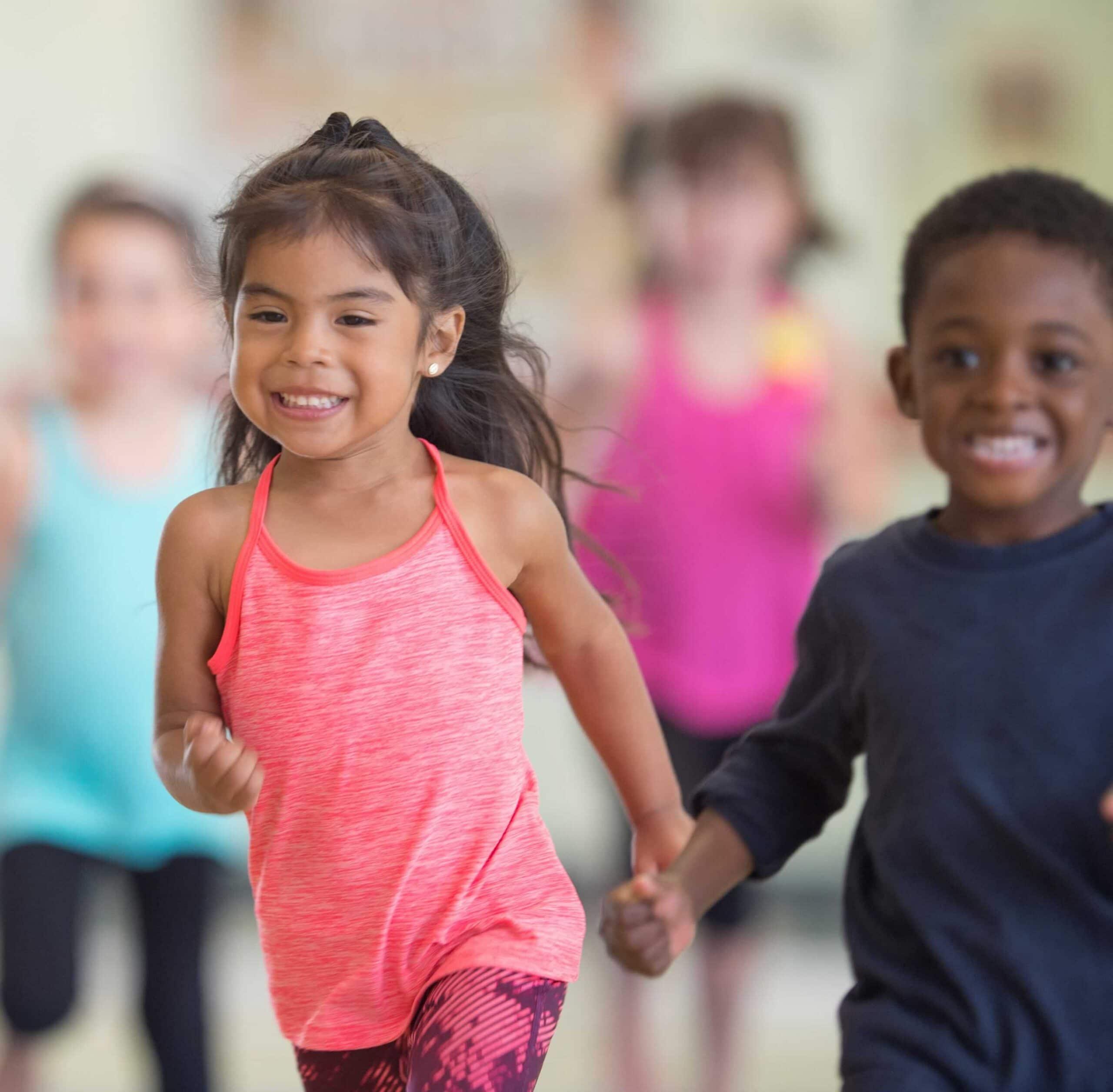 Children running and smiling.