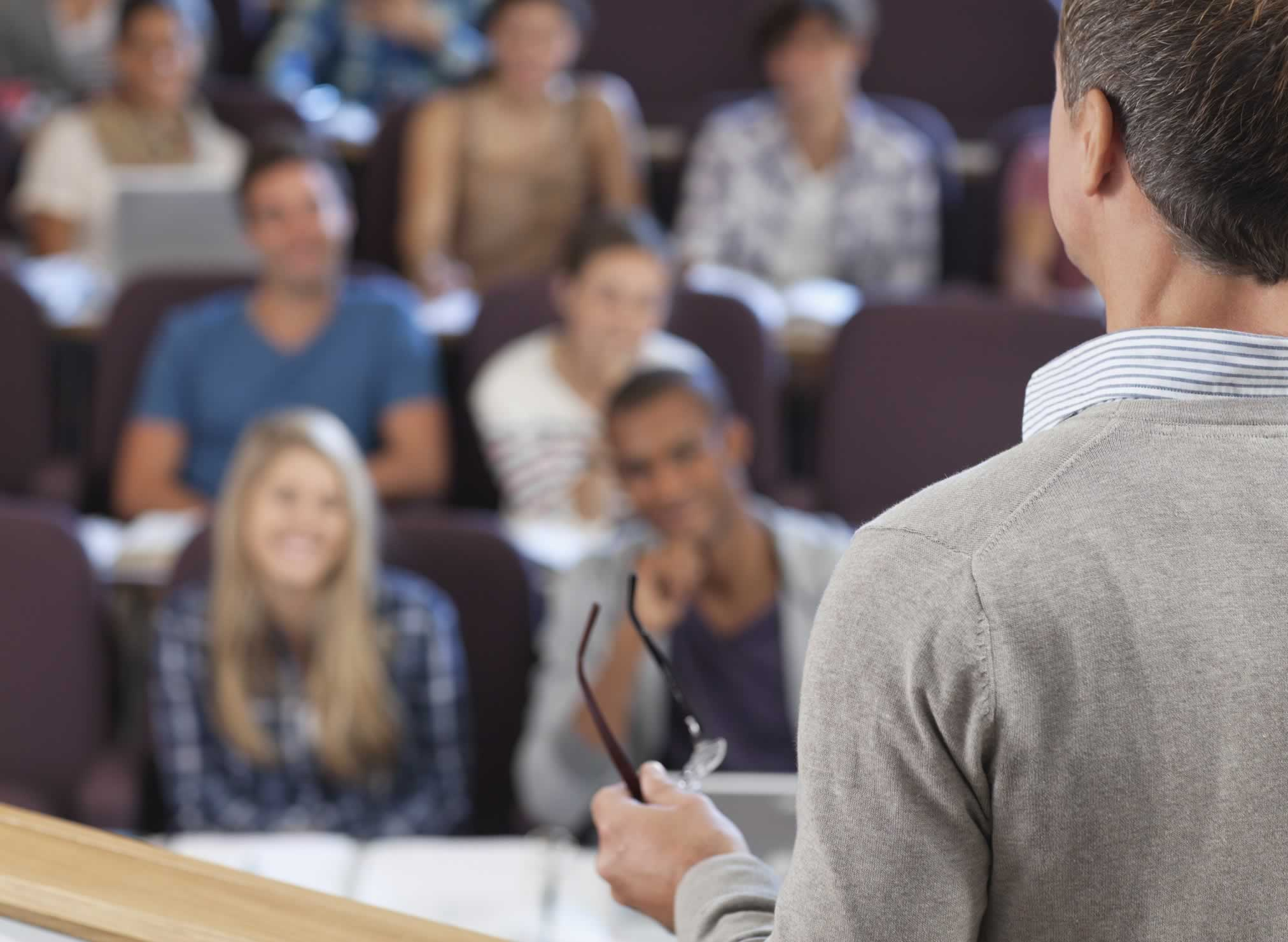 College students listen to their professor during a lecture