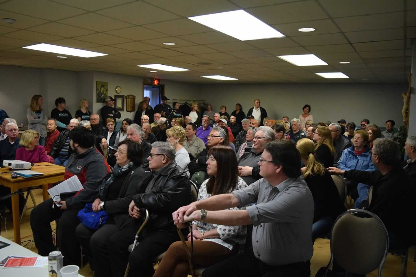 Packed room, including some OPSEU members wearing We Own It shirts, for a Belle River community meeting