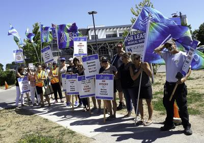 OPSEU Local 276 members picket outside of Owen Sound Family Health Organization.