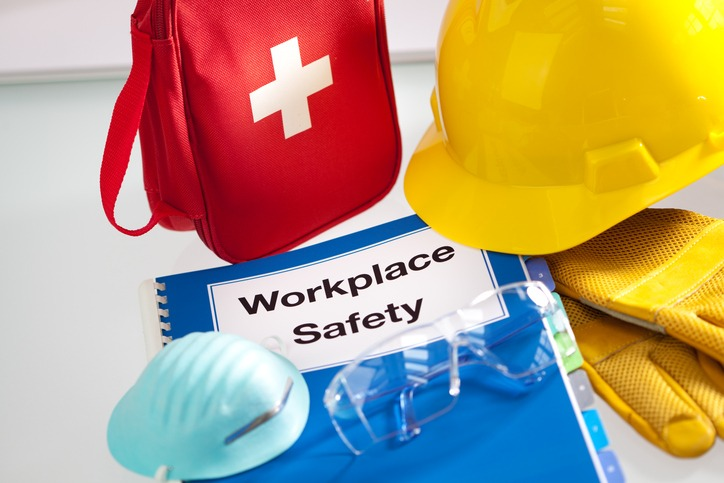 Workplace Safety booklet, mask, first aid kit, helmet and gloves.
