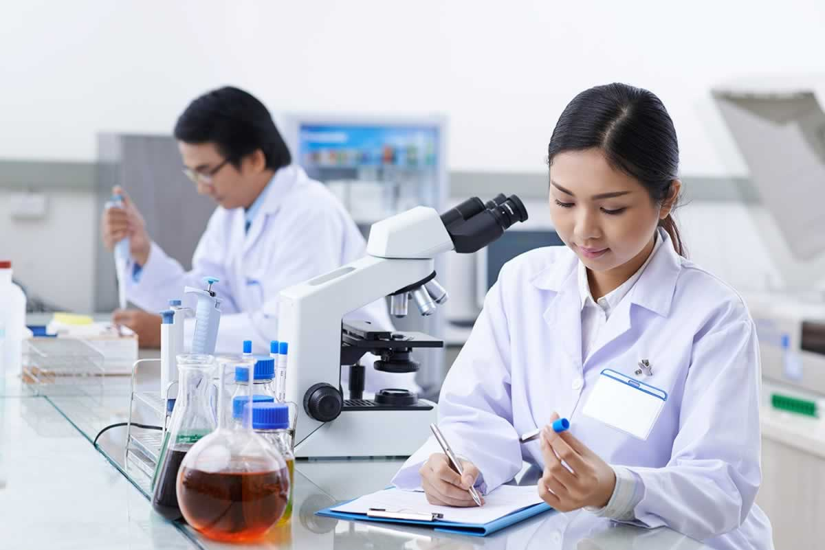 Lab professionals at work in a lab.