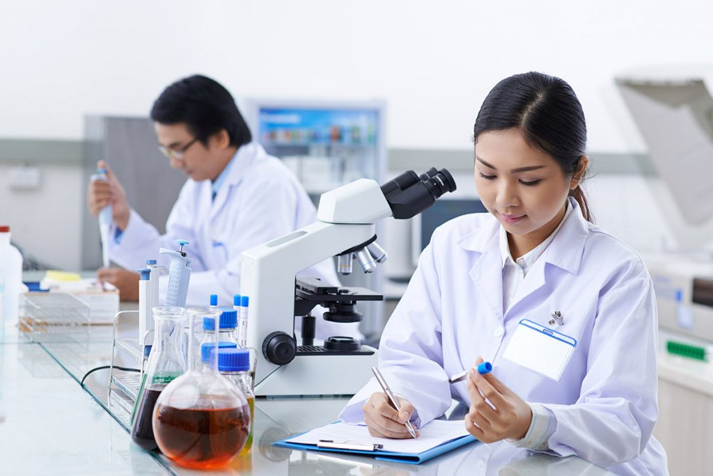 Two workers in a lab