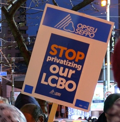 "Picket sign reading ""Stop privatizing our LCBO"" at a rally."