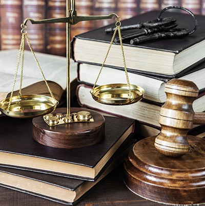 Scales, gavel, and legal texts