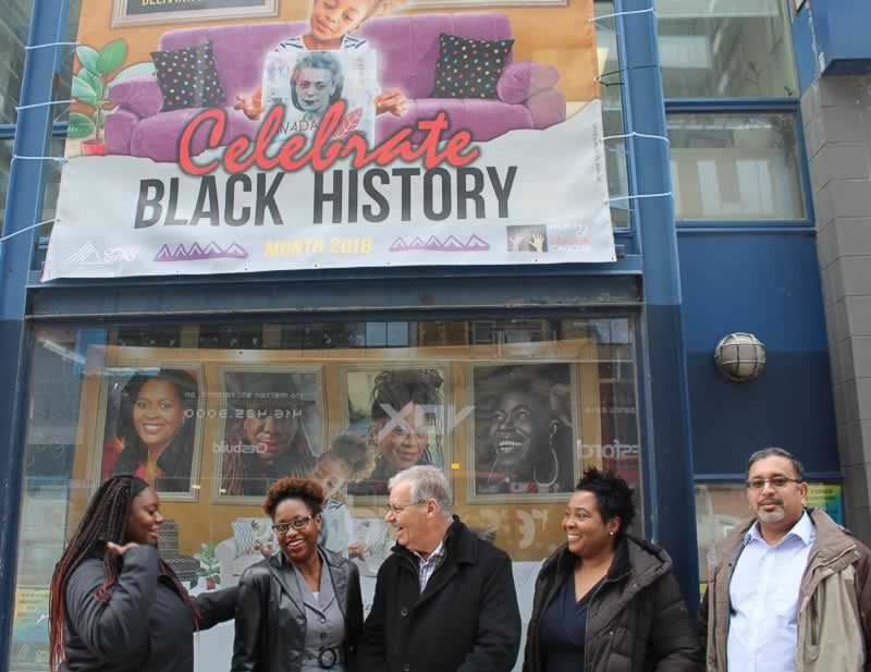 OPSEU President Warren (Smokey) Thomas with members beneath a Celebrate Black History Month banner
