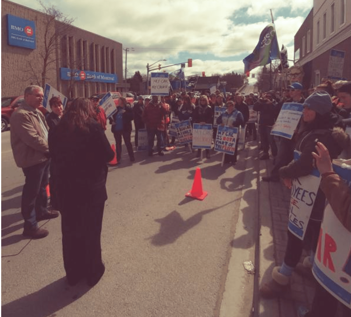 OPSEU President Warren (Smokey) Thomas speaks to a large crowd of OPSEU members, many of them holding picket signs, during a rally at Community Living Campbellford/Brighton.