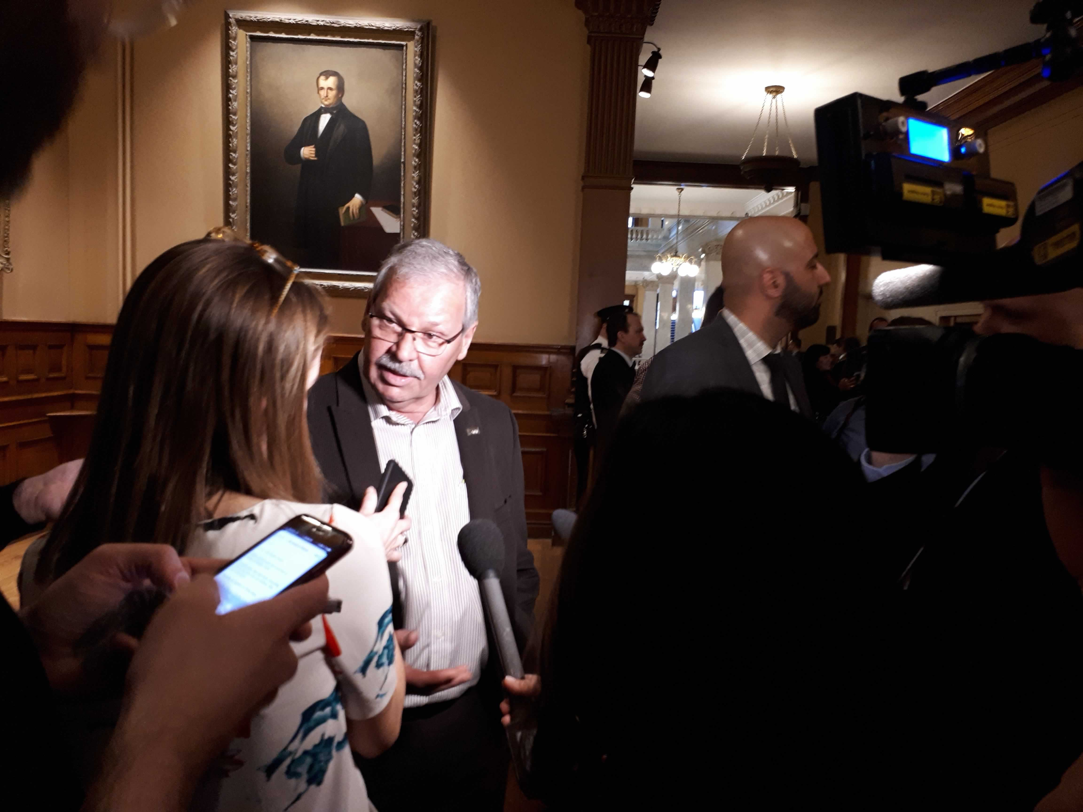 OPSEU President Warren (Smokey) Thomas speaks to reporters at Queen's Park.