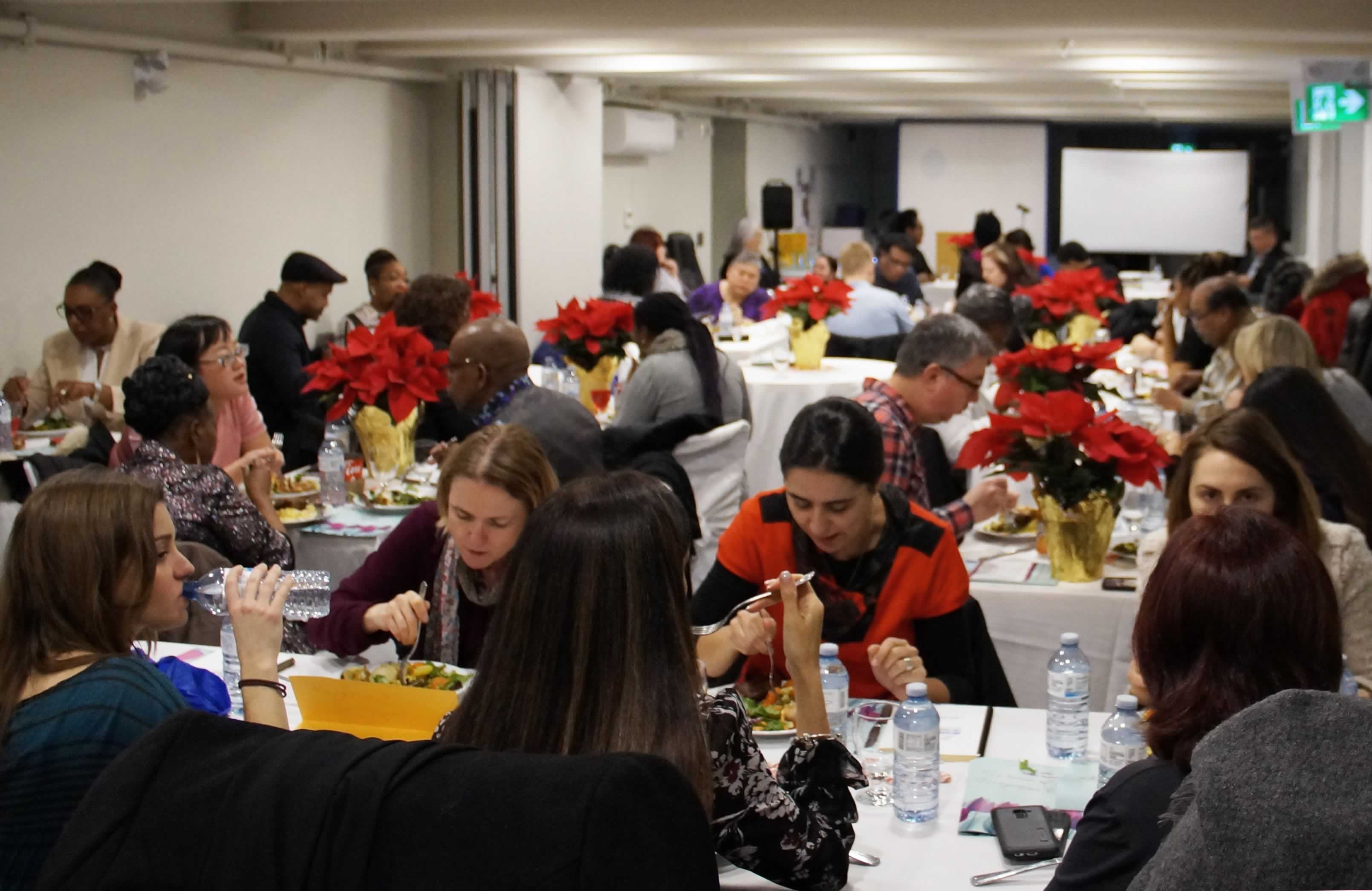 People eat during OPSEU Region 5 event recognizing women of impact
