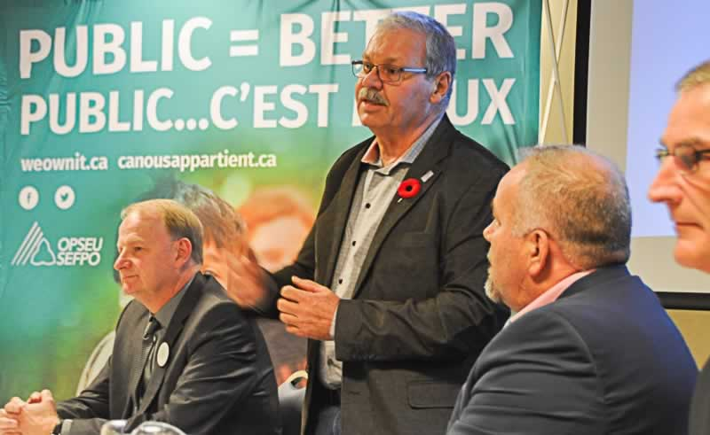 OPSEU President Warren (Smokey) Thomas speaks during a We Own It town hall in Belleville