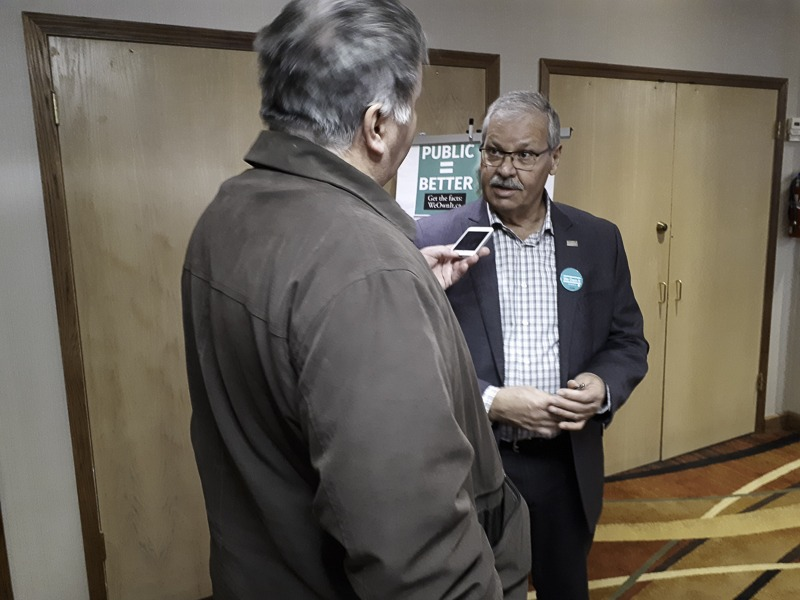 OPSEU President Warren (Smokey) Thomas speaks to a reporter after the Kenora We Own It town hall