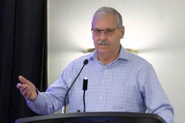 Smokey Thomas speaking at podium