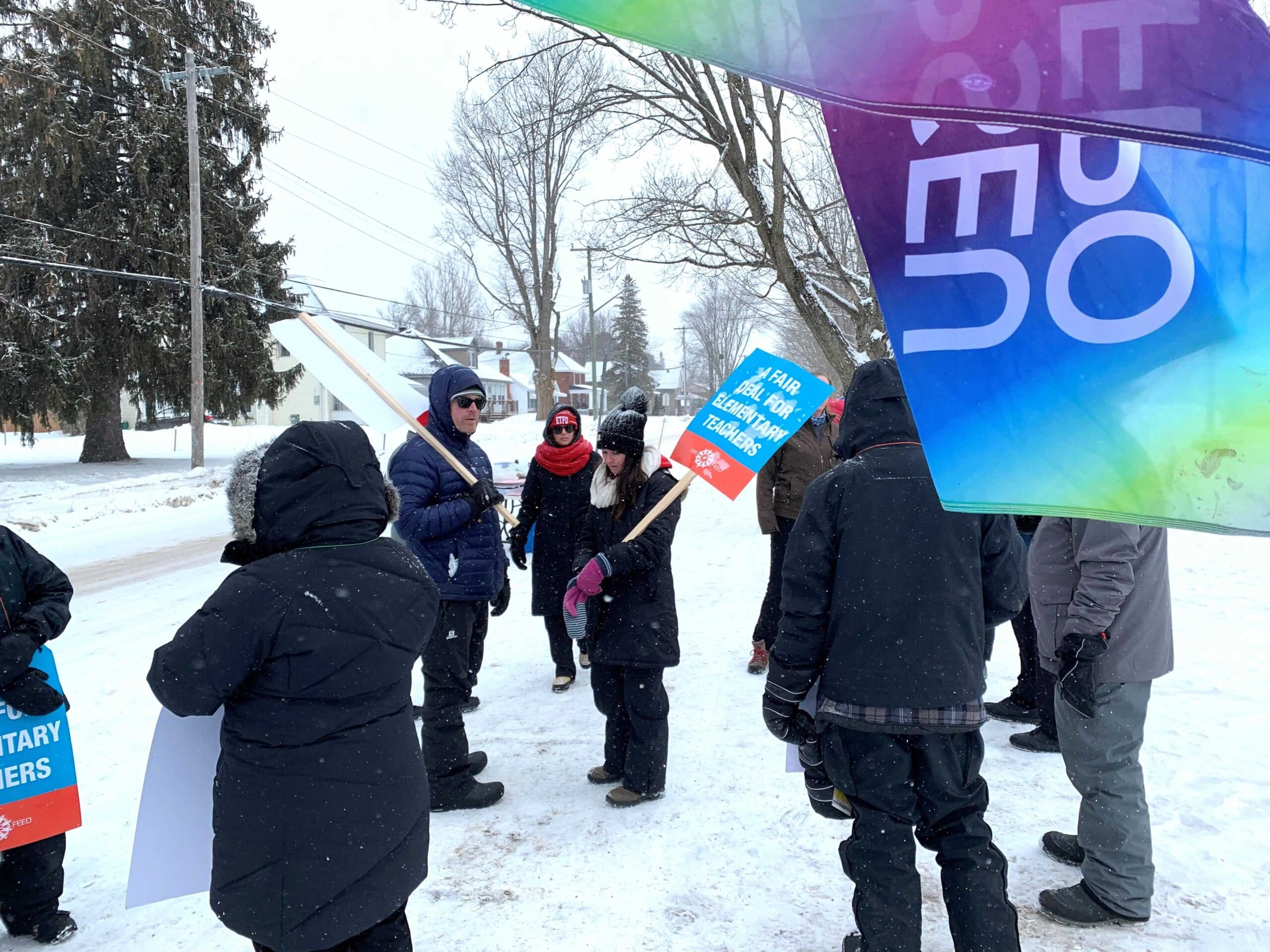 OPSEU members standing outside of school to protest