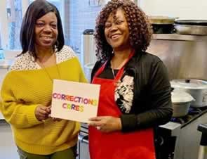 Corrections Cares: two women holding sign