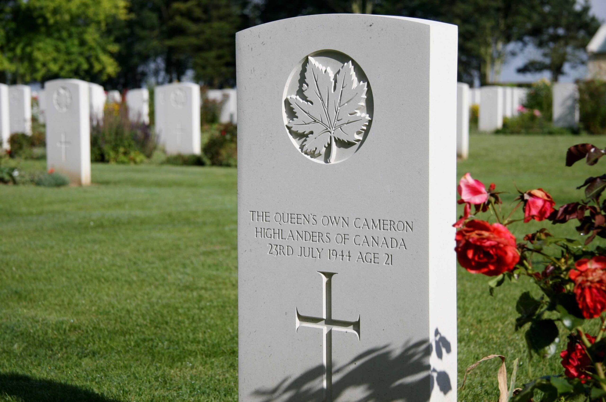 Headstone of 21 year old fallen soldier. Shot taken at the memorial Canadian cemetery in Normandy France, Bény-sur-Mer Canadian War Cemetery.