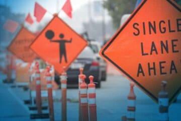 Single lane ahead sign on highway